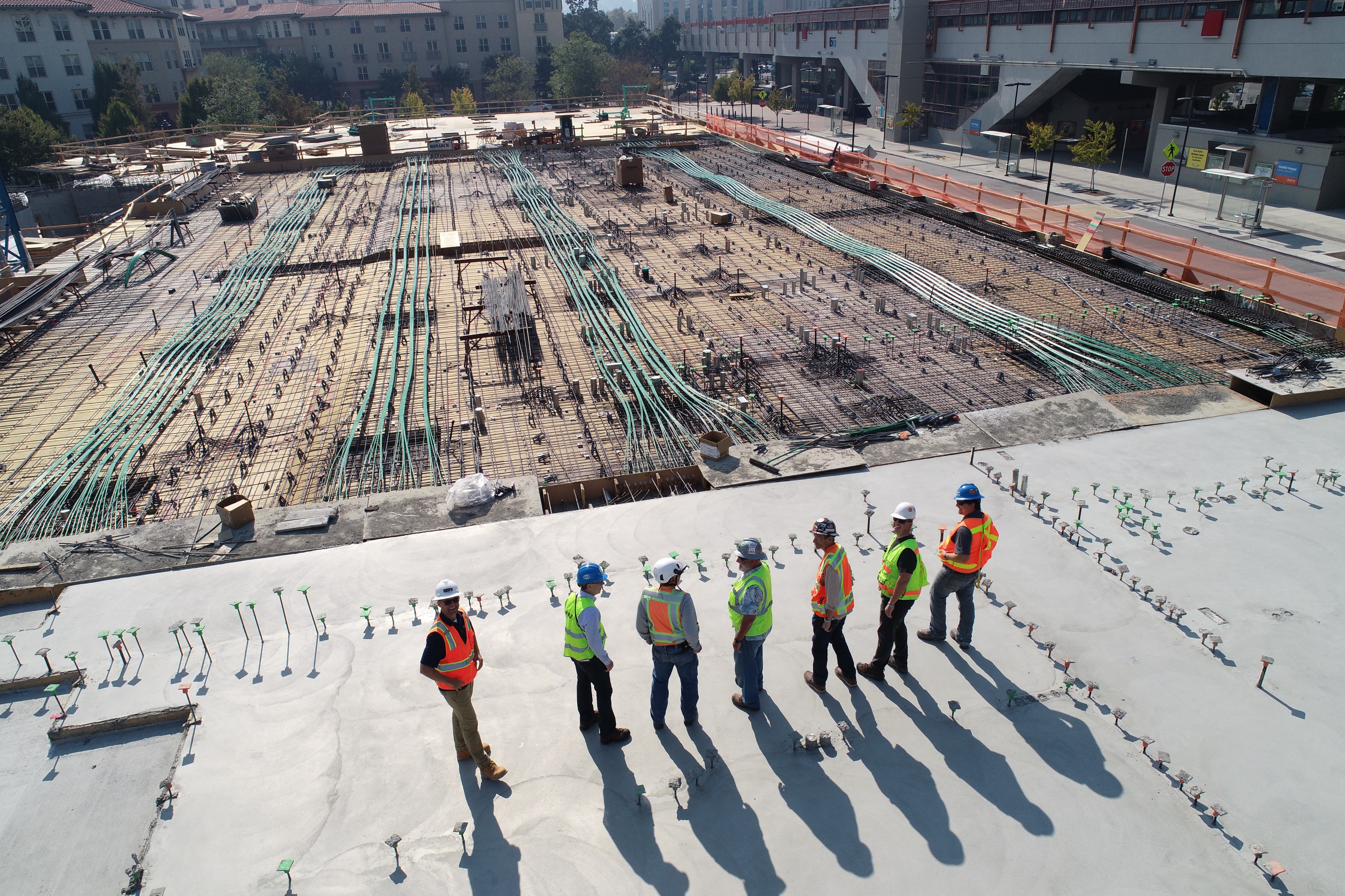 Seven construction workers standing on a construction site