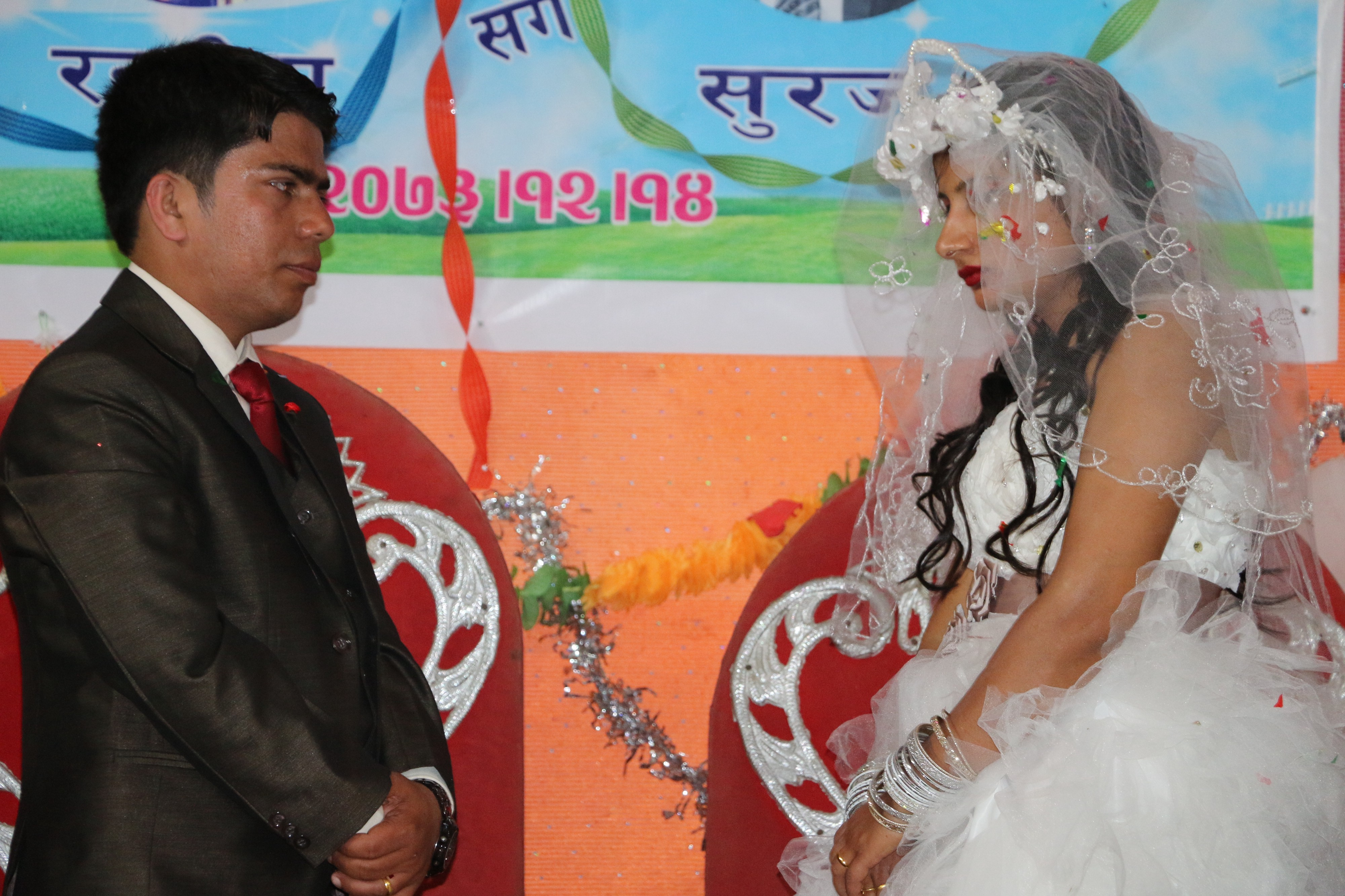 We each married a stranger, that's why we do not look happy in the day wedding day. My wife and I in the picture.