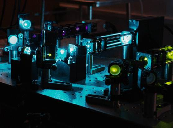 A basic photoacoustic setup using multiple lasers and lenses.