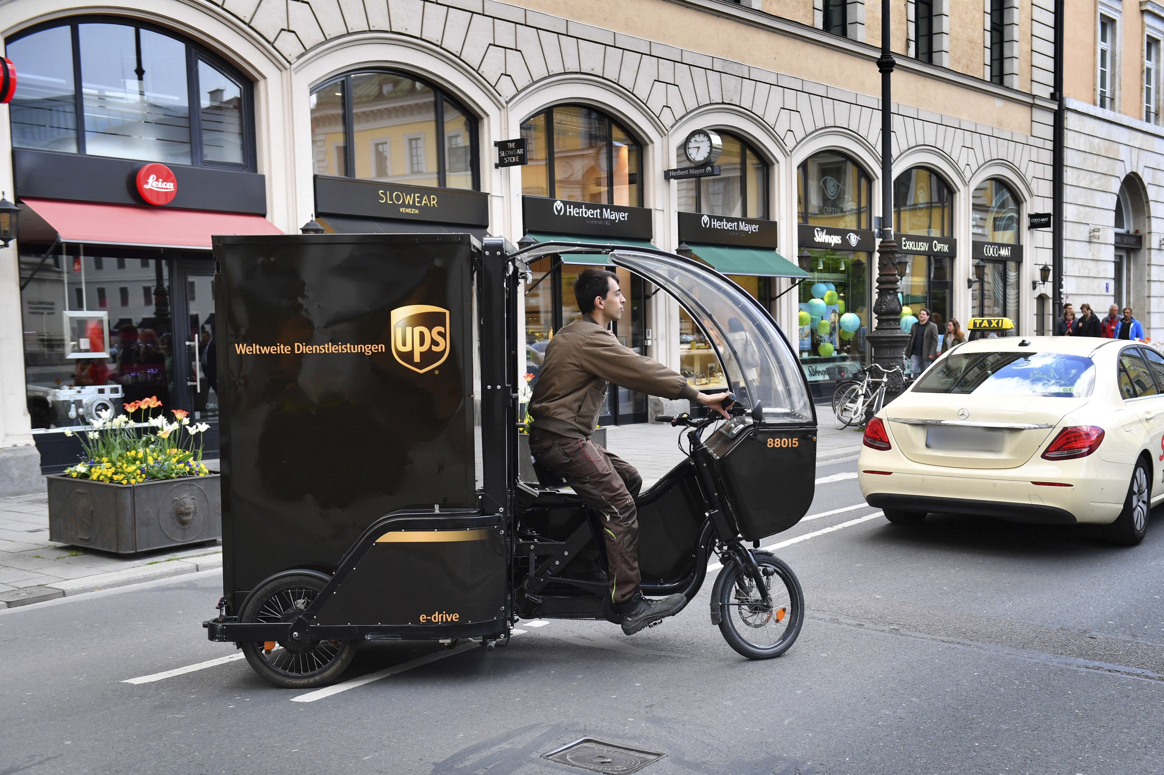 A photograph of a UPS electric delivery freight bike on the streets of Munich, Germany.