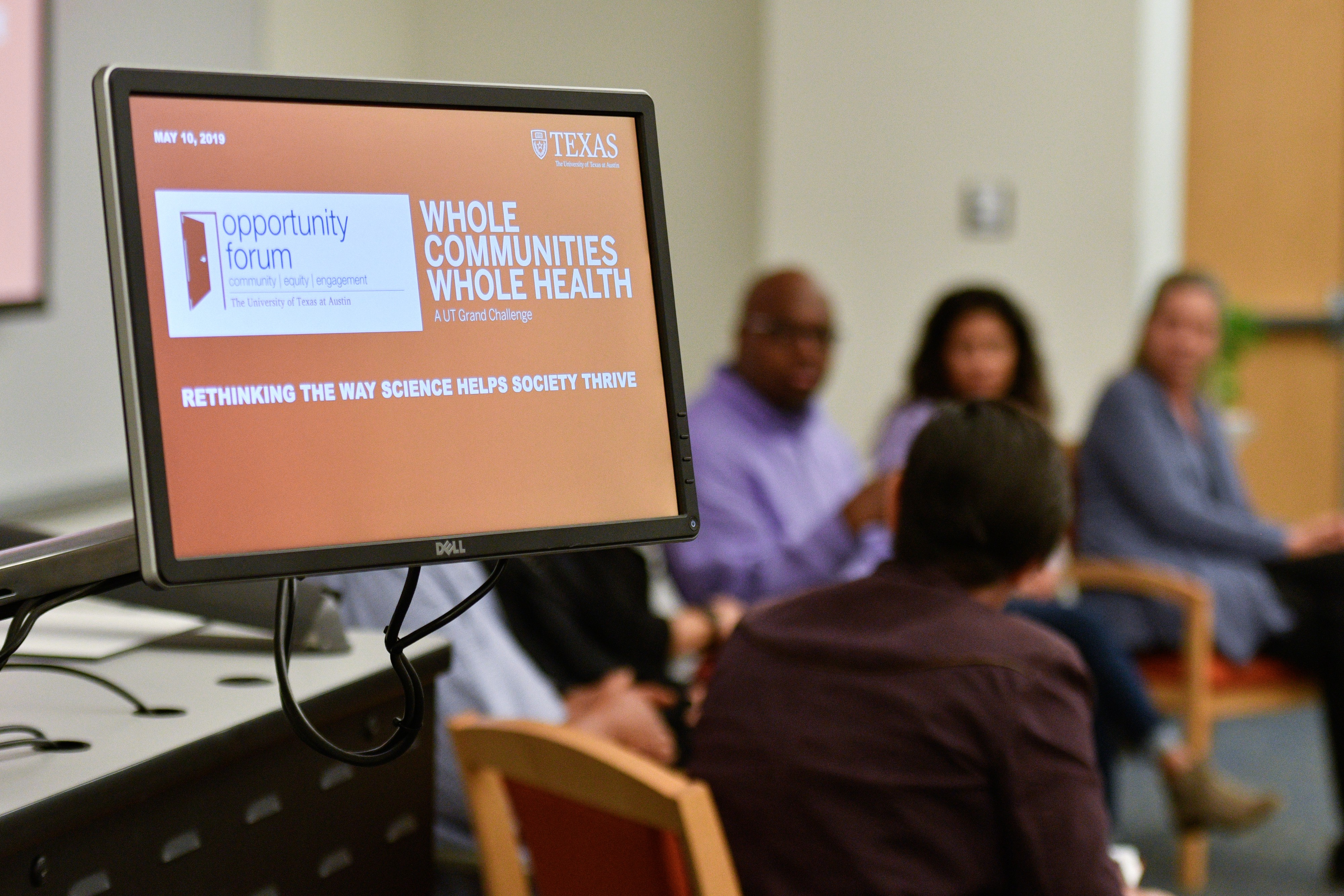 Whole Communities–Whole Health researchers and community advisors sit together on an Opportunity Forum panel.