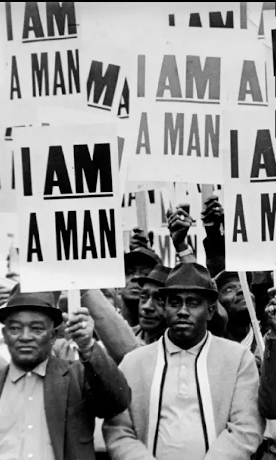 "Black civil rights movement protestors holding signs reading ""I Am a Man."""