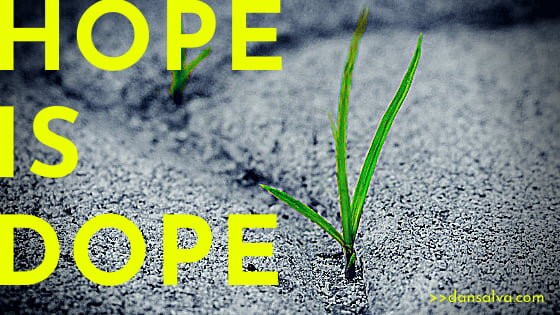 Grass growing up through a sidewalk crack with the headline: Hope Is Dope