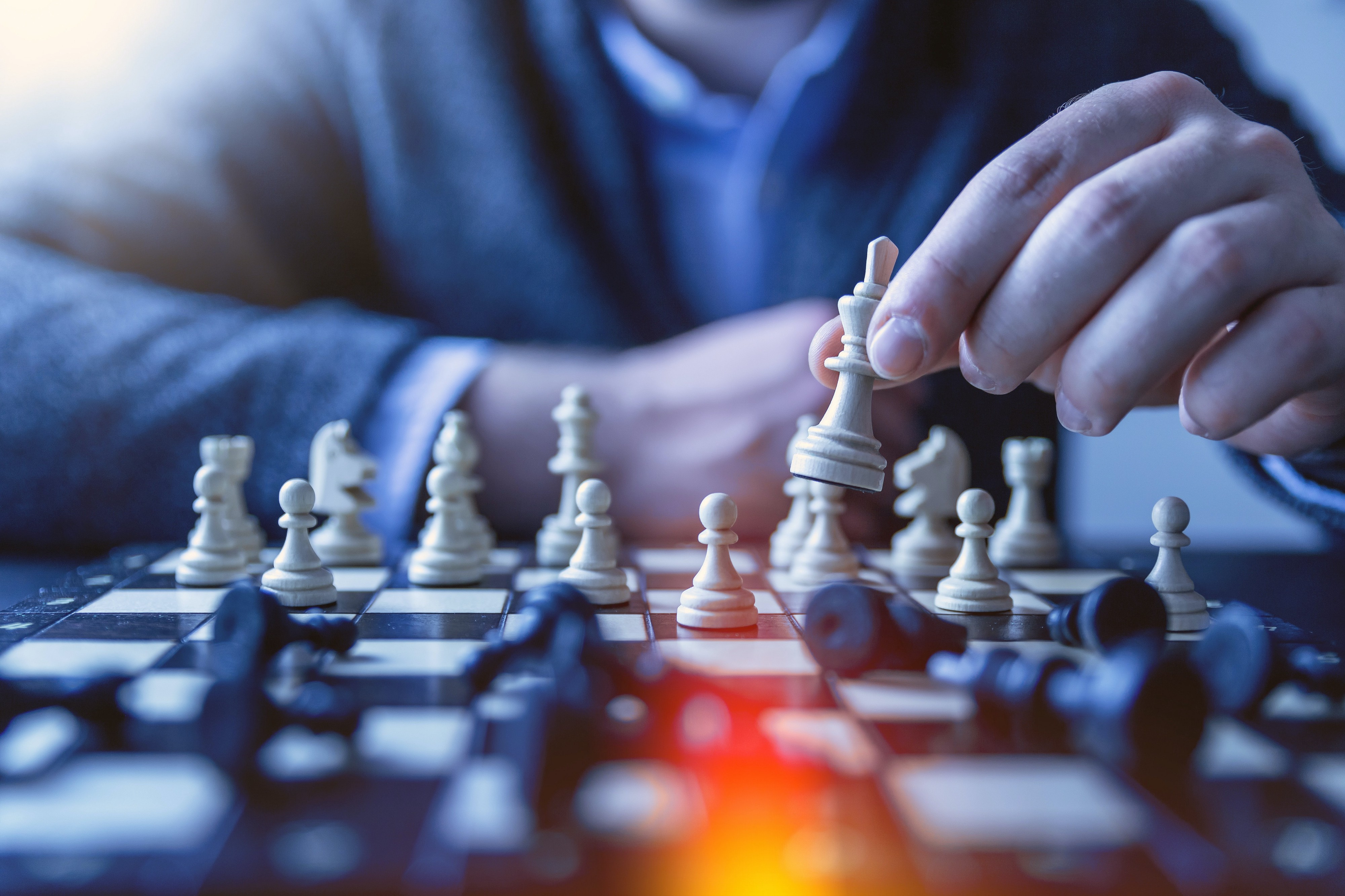 Color image of man playing chess