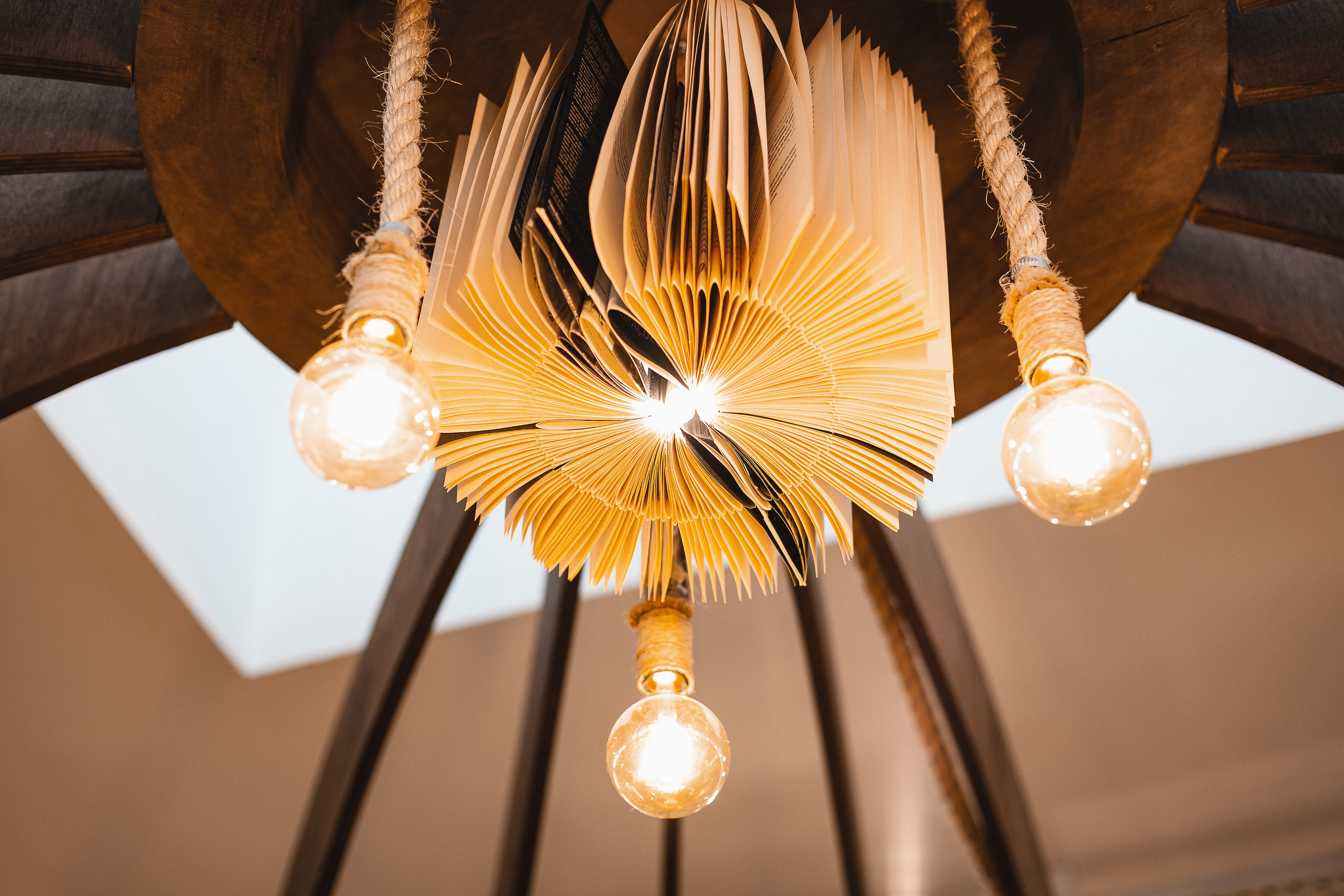 Lamp made of old books with hanging light bulbs