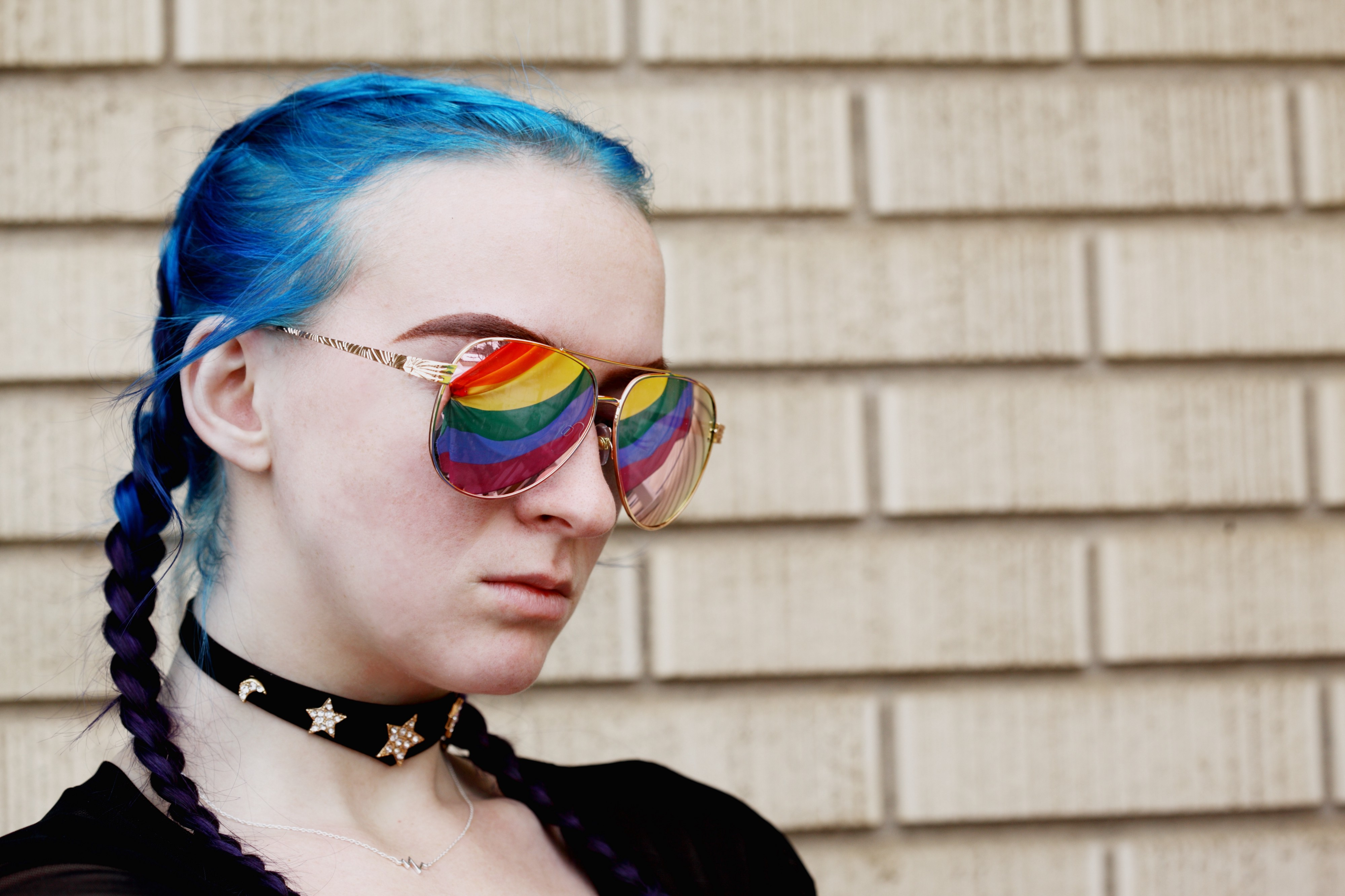 Someone with rainbow flags in their sunglasses. Maybe they're looking for the bi flag, which is not on Unsplash.