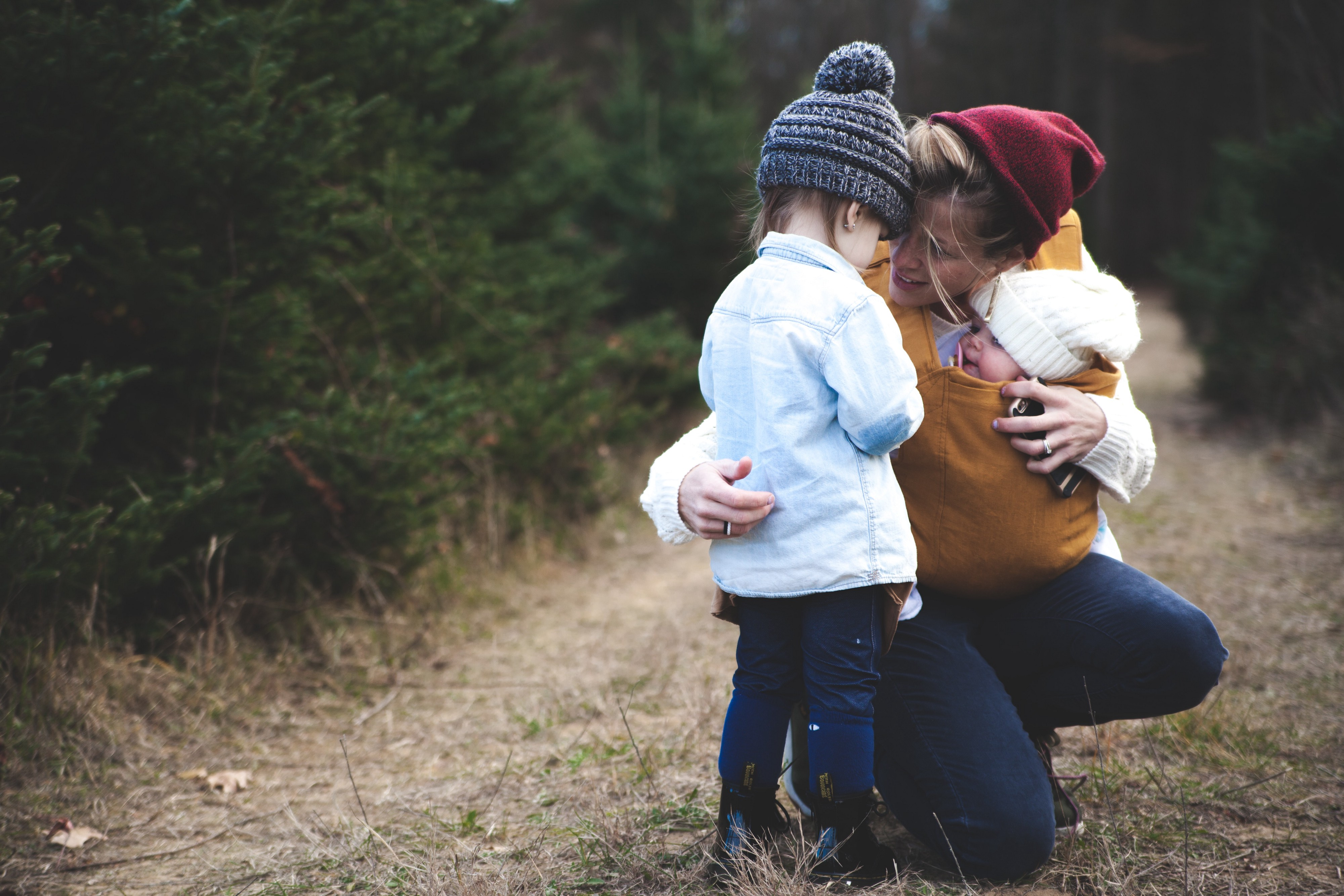 mother and two children hiking. image courtesy of pexels.com