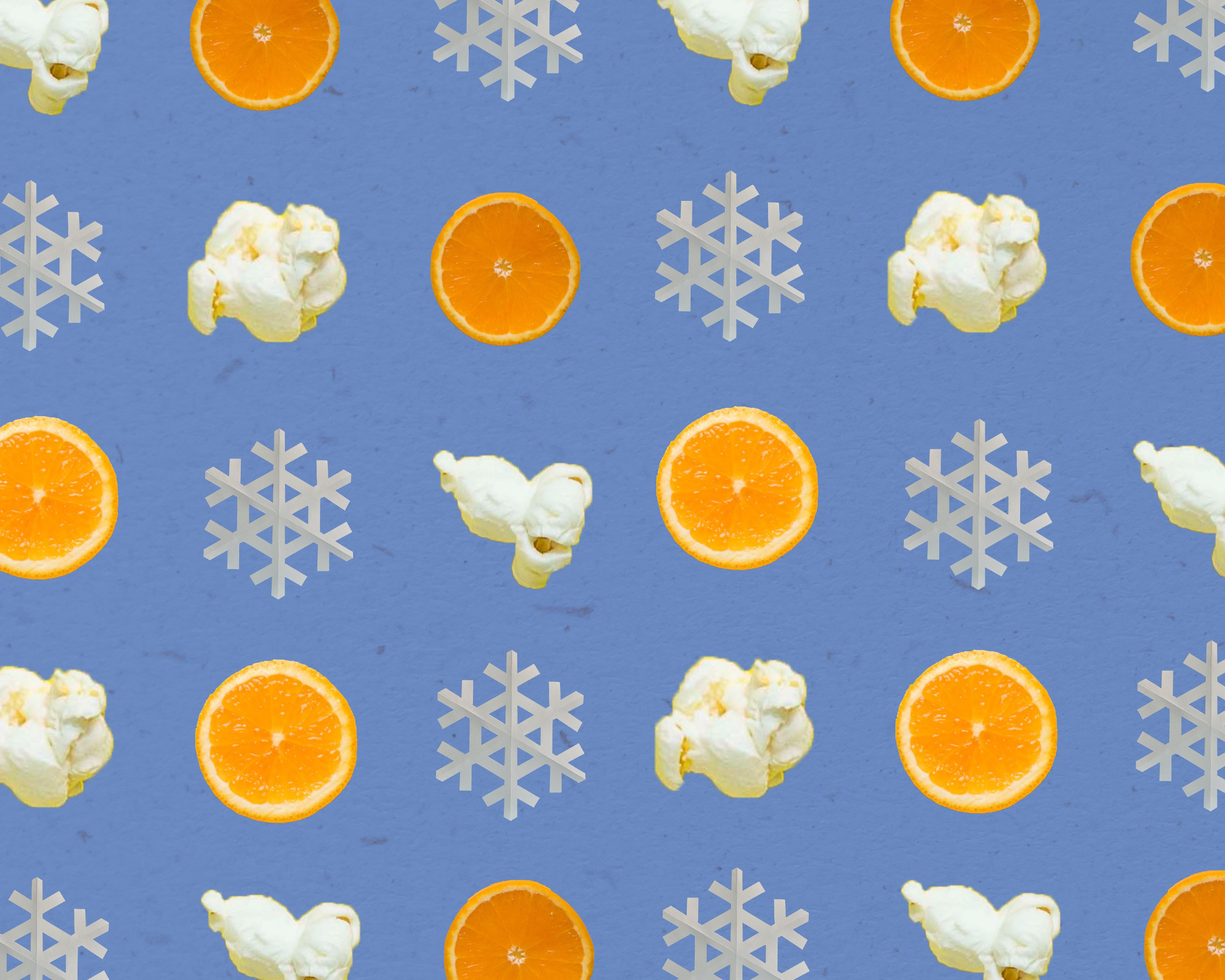 A background type pattern design consisting of orange slices, popcorn, and snowflakes on a blue background