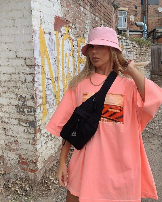 TikTok must have's: oversized shirt and a bucket hat.