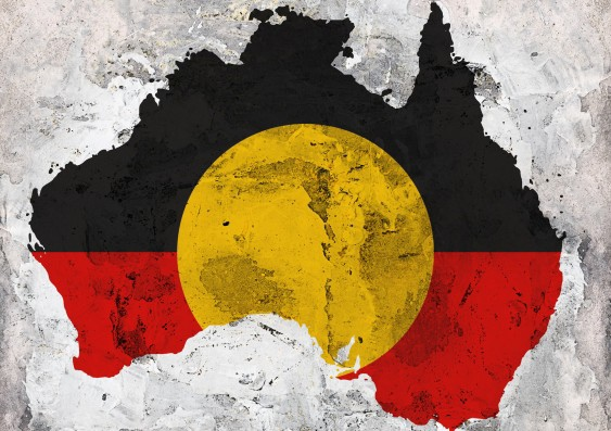 A picture of the continent of Australia with the Indigneous flag across it: black and red, with a yellow circle.