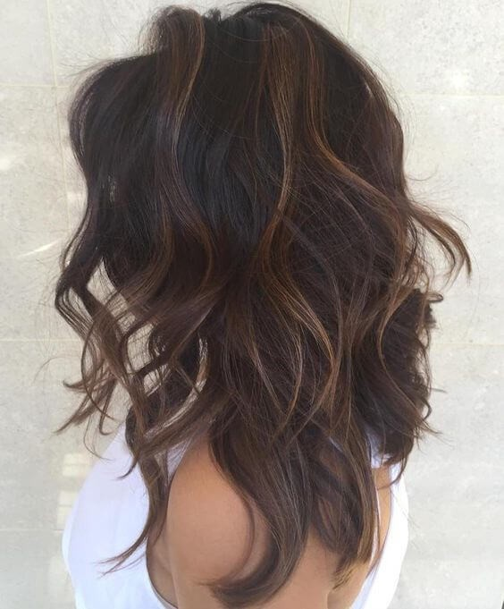 Dark brown hair and subtle blonde highlights is a way to get a new spring look with minimum damage to your hair