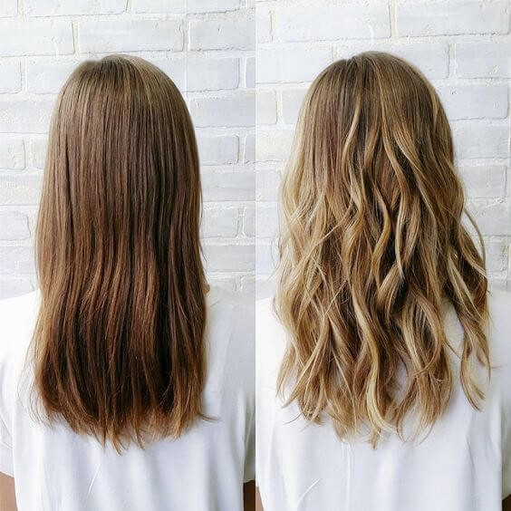 You can never go wrong with a sun-kissed look. Check out this side-by-side comparison of a woman's light brown hair before and golden blonde highlights after.