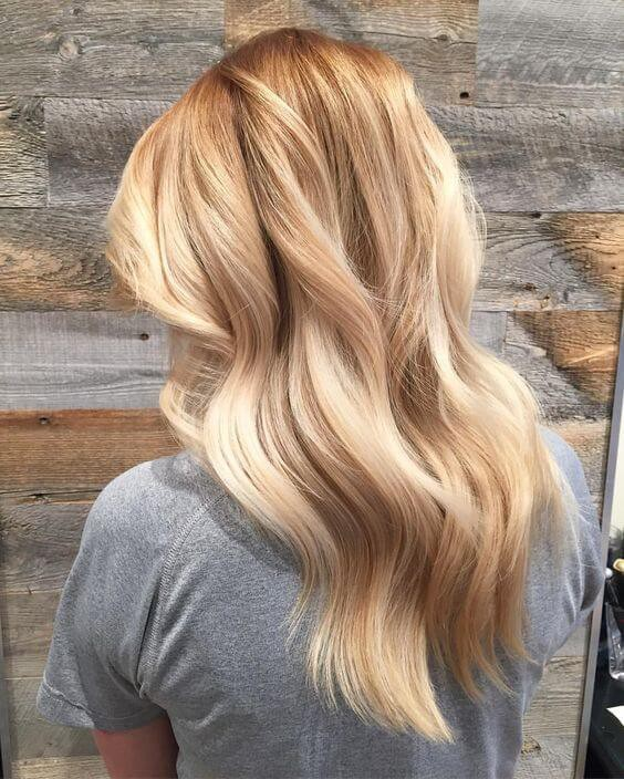 Freshen up your look for spring by adding these three-dimensional golden blonde highlights and lowlights