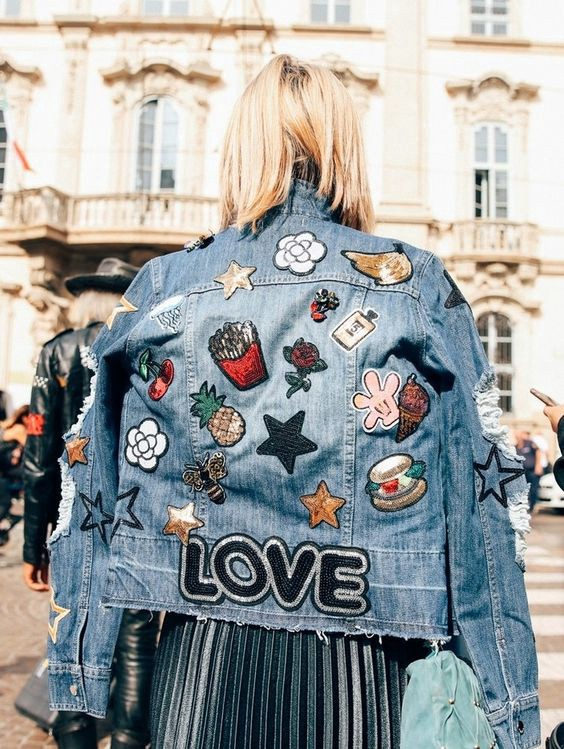 patches and pins on denim jacket