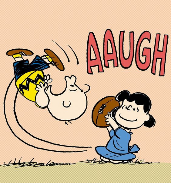 """Peanuts"" comic with Lucy moving the football when Charlie Brown tries to kick it."