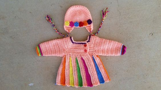 A pleated crochet sweater for a little girl with multi-color pleats and a crochet hat to coordinate