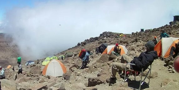 Shows tents strewn among the rocks on Barafu Camp KilimanjaroImage of tents strewn among the boulders of Barafu Camp on Mount Kilimanjaro.