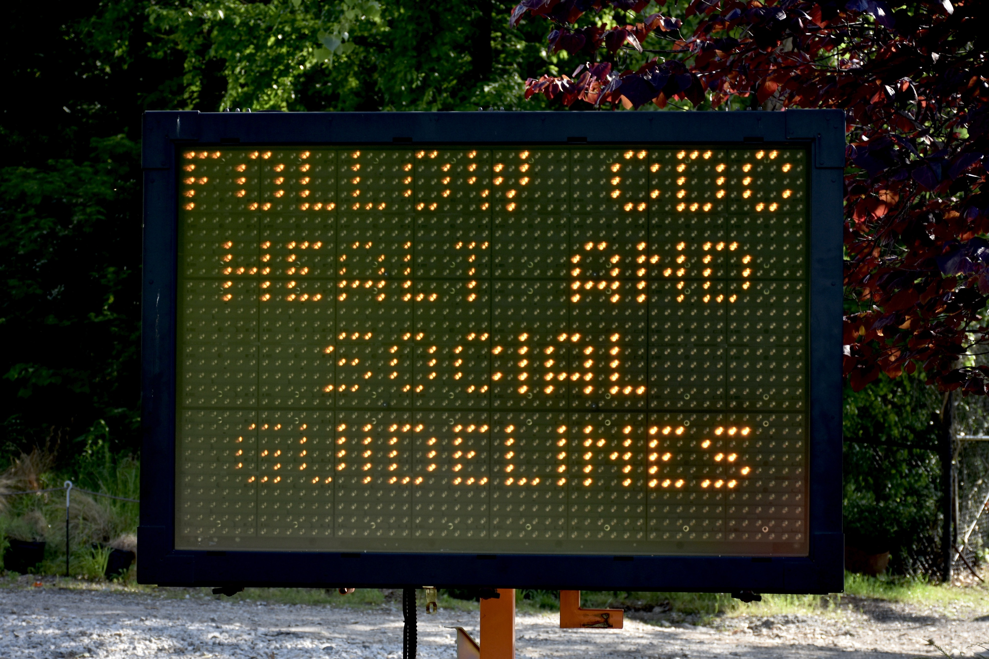 A digital traffic sign (with typo) alerts people to find and refer to CDC guidelines during the COVID-19 pandemic.