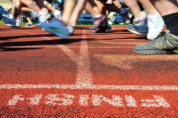Runners at finish line of track