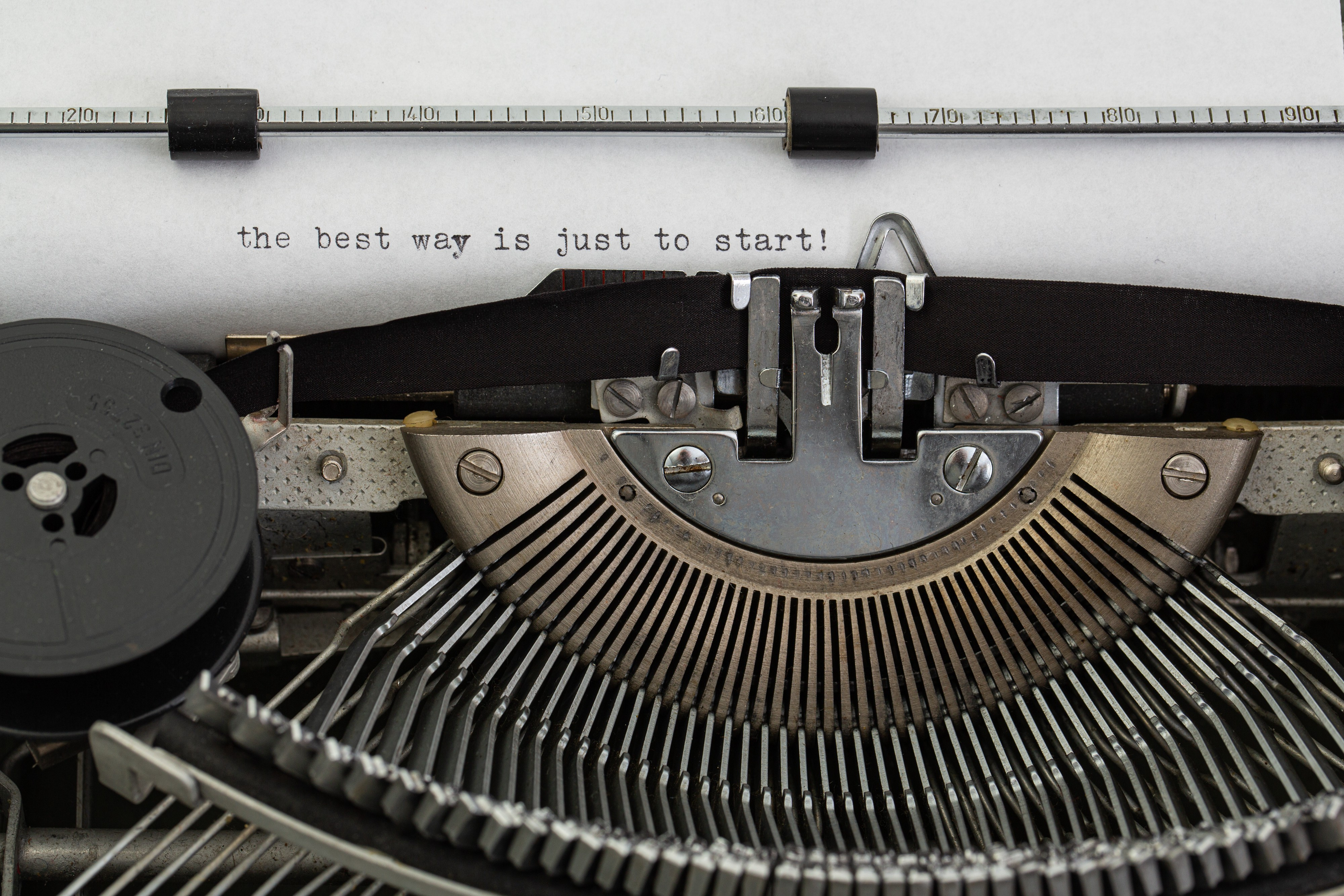 Typewriter with the words the best way is to just start written on paper