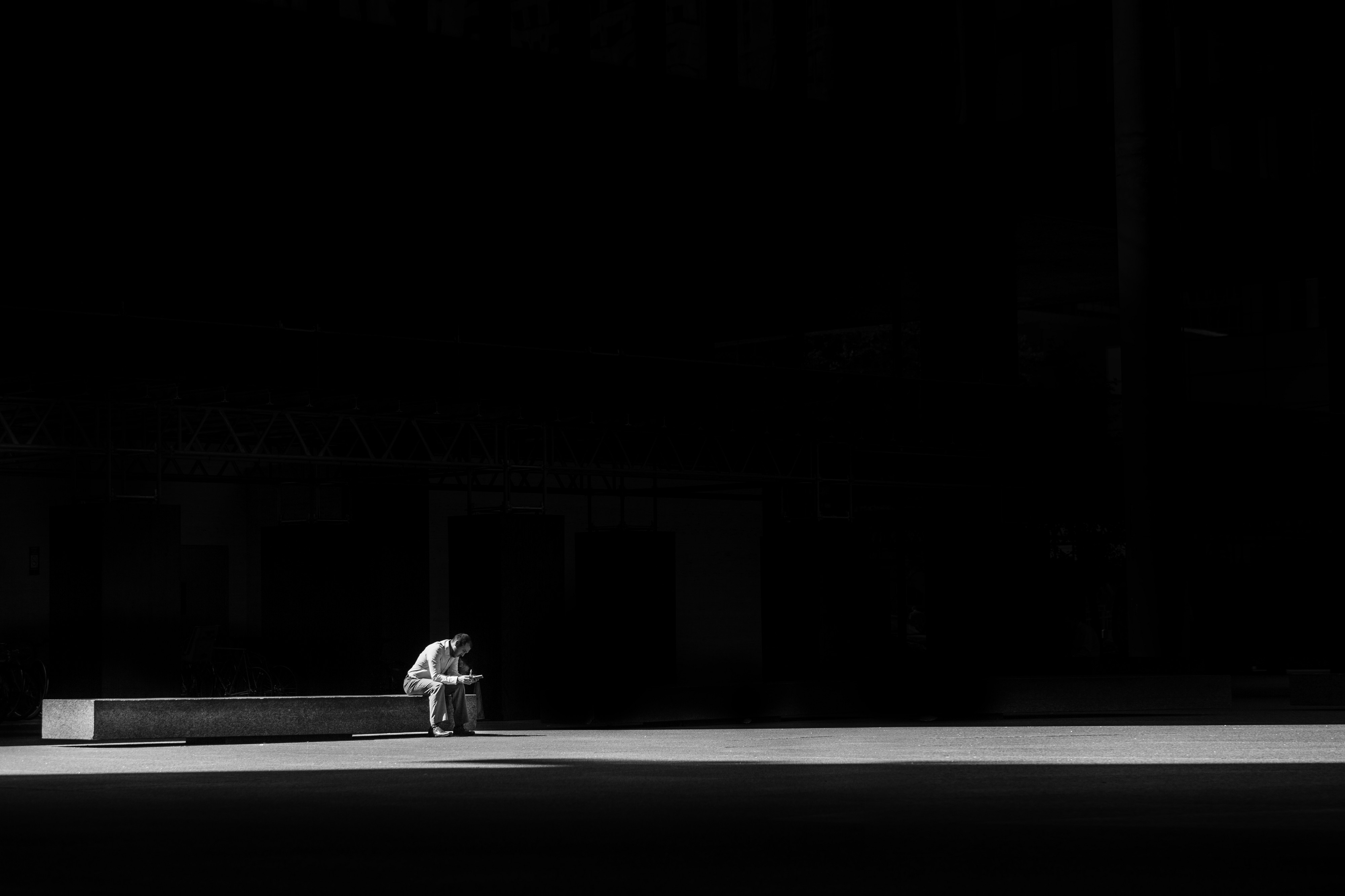 """Black and white image of a man sitting on a bench for article titled """"the closest I've come"""""""