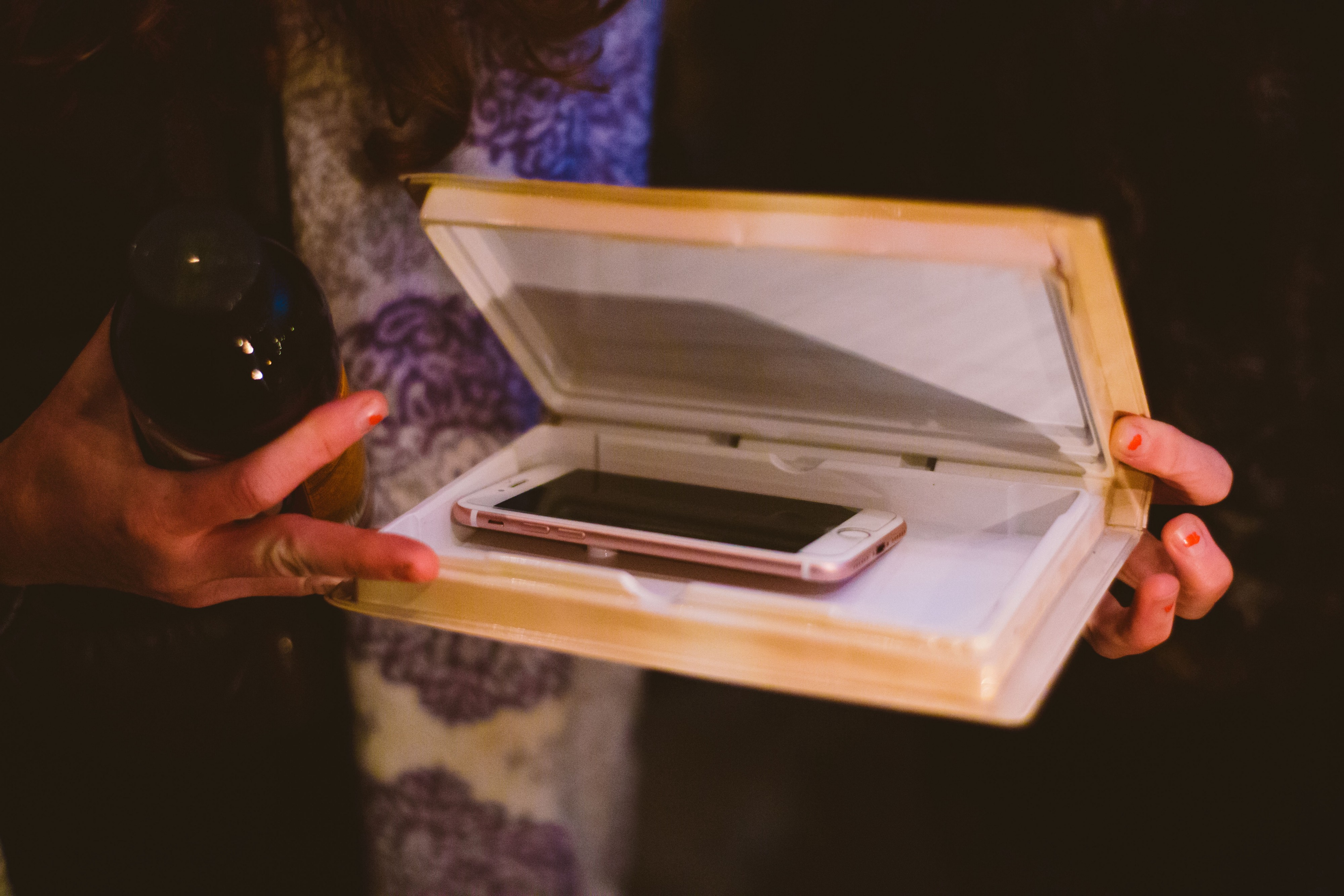 A photo of a iPhone being put away in a case.