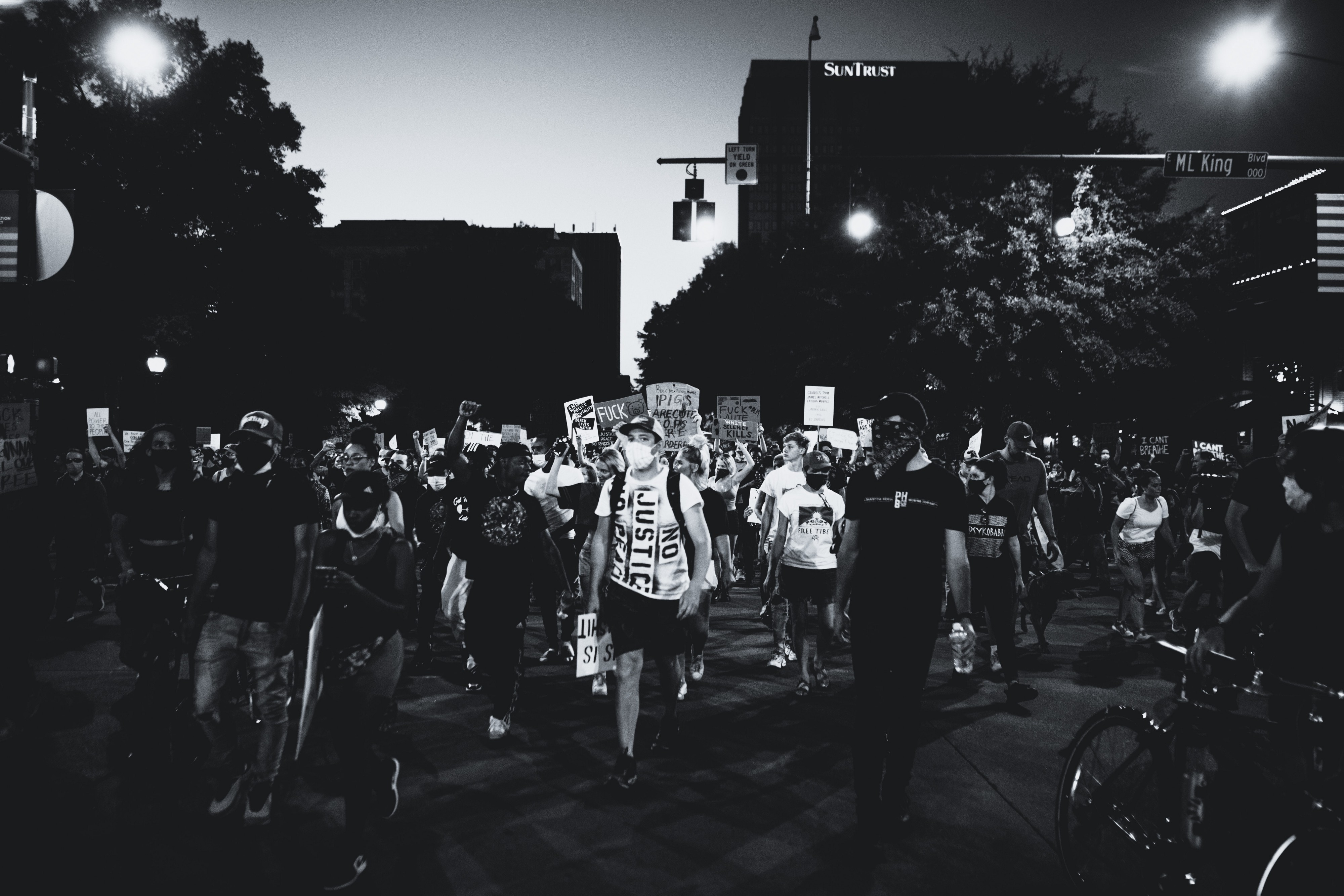 Black and white photo of a crowd at part of a peaceful racial justice protest.