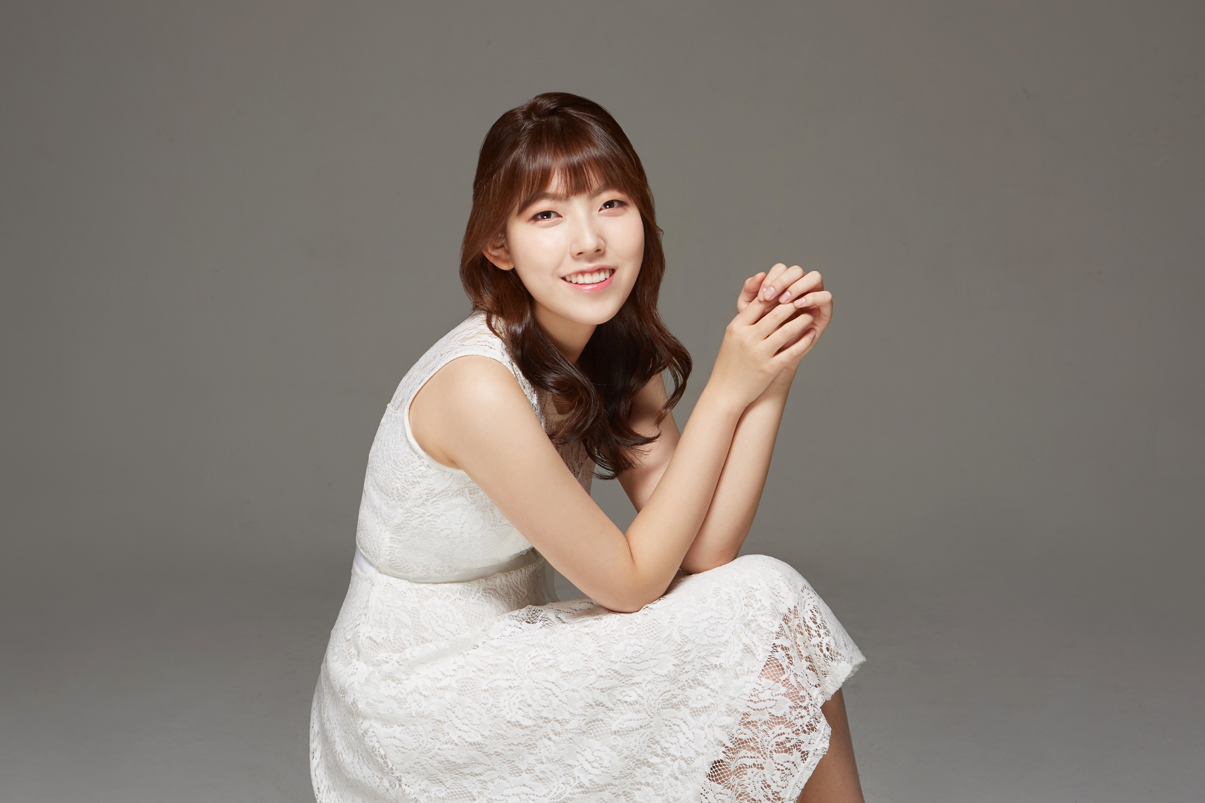 Composer SiHyun Uhm in a white dress, looking at the camera