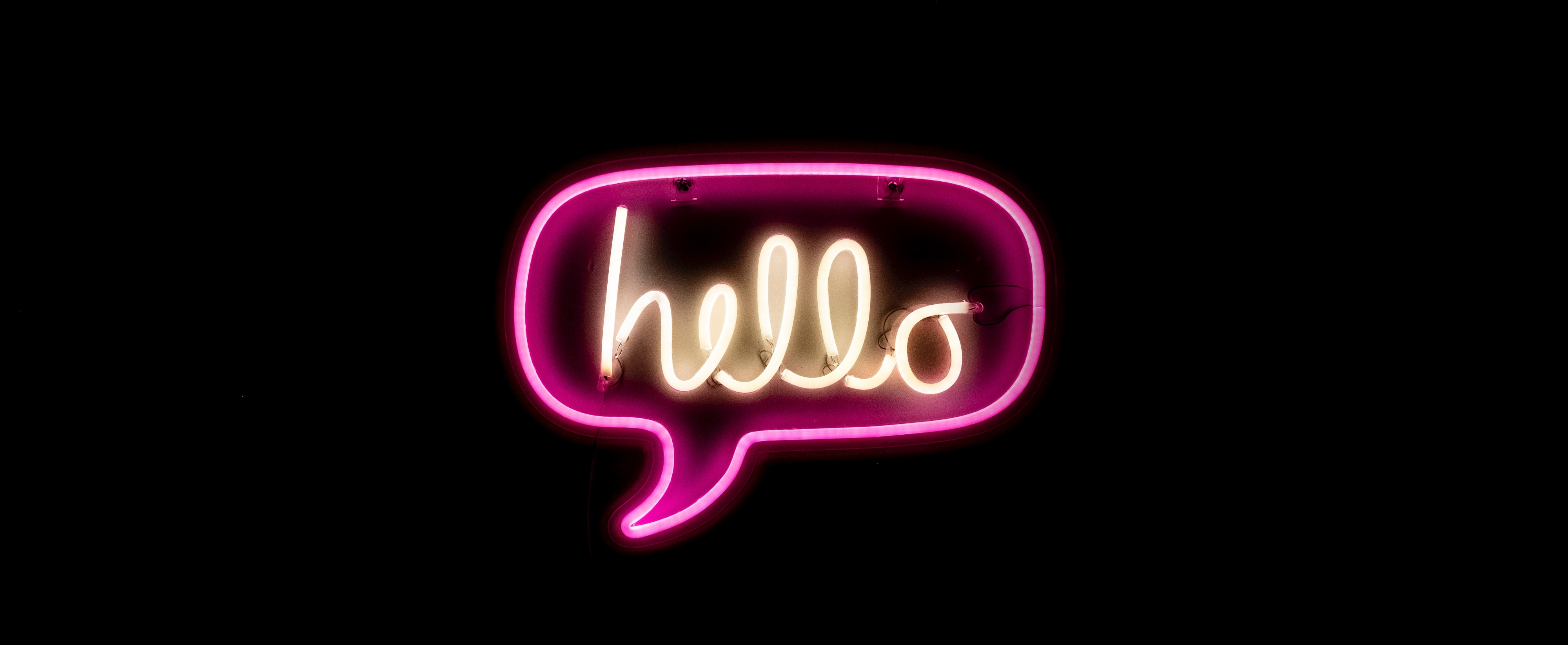 """neon sign that says """"hello"""""""