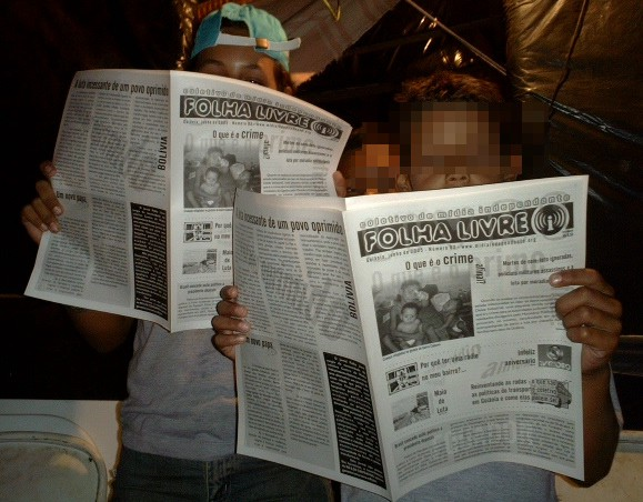 "Young boys reading an Indymedia Newspaper called ""Folha Livre"" (Free — as in freedom — News)"