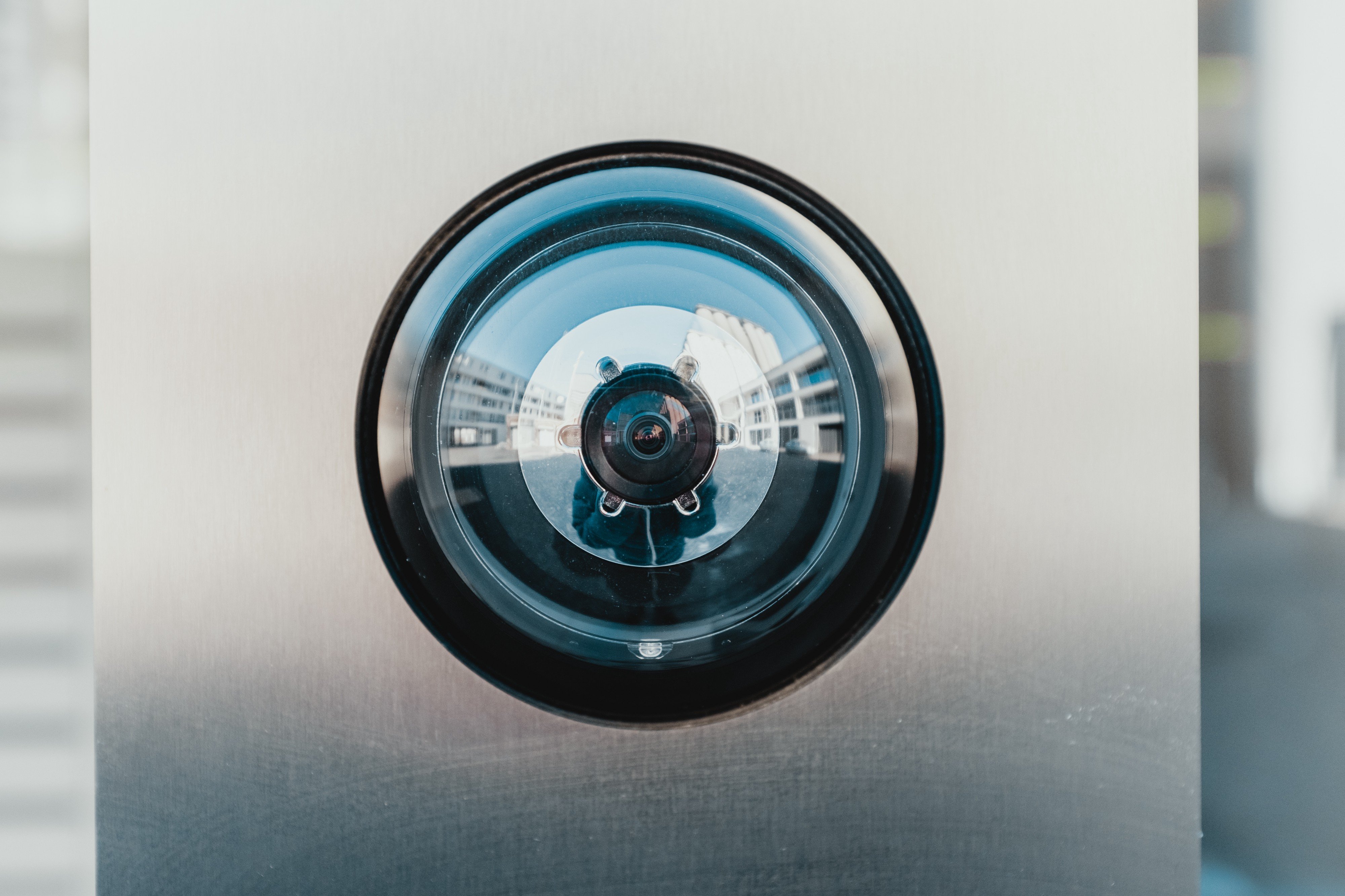 image of a person looking into door peep hole from the outside