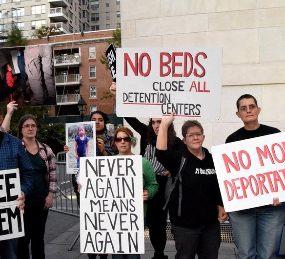 close the camps protest signs: never again, no more deportations