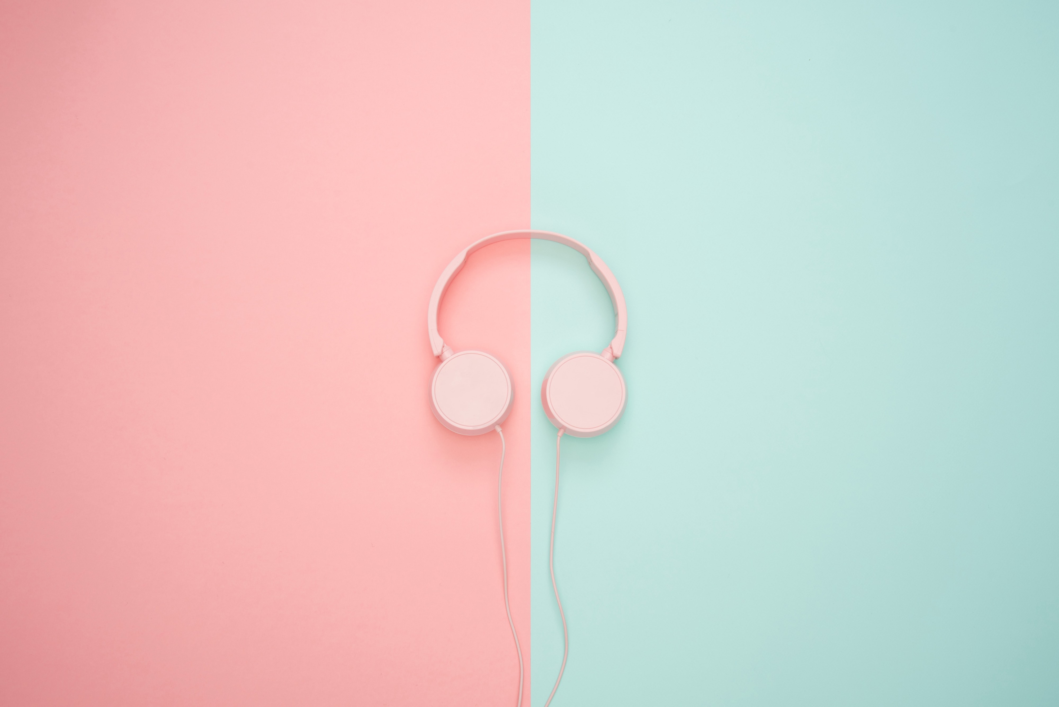 pink headphones on a pink and teal background