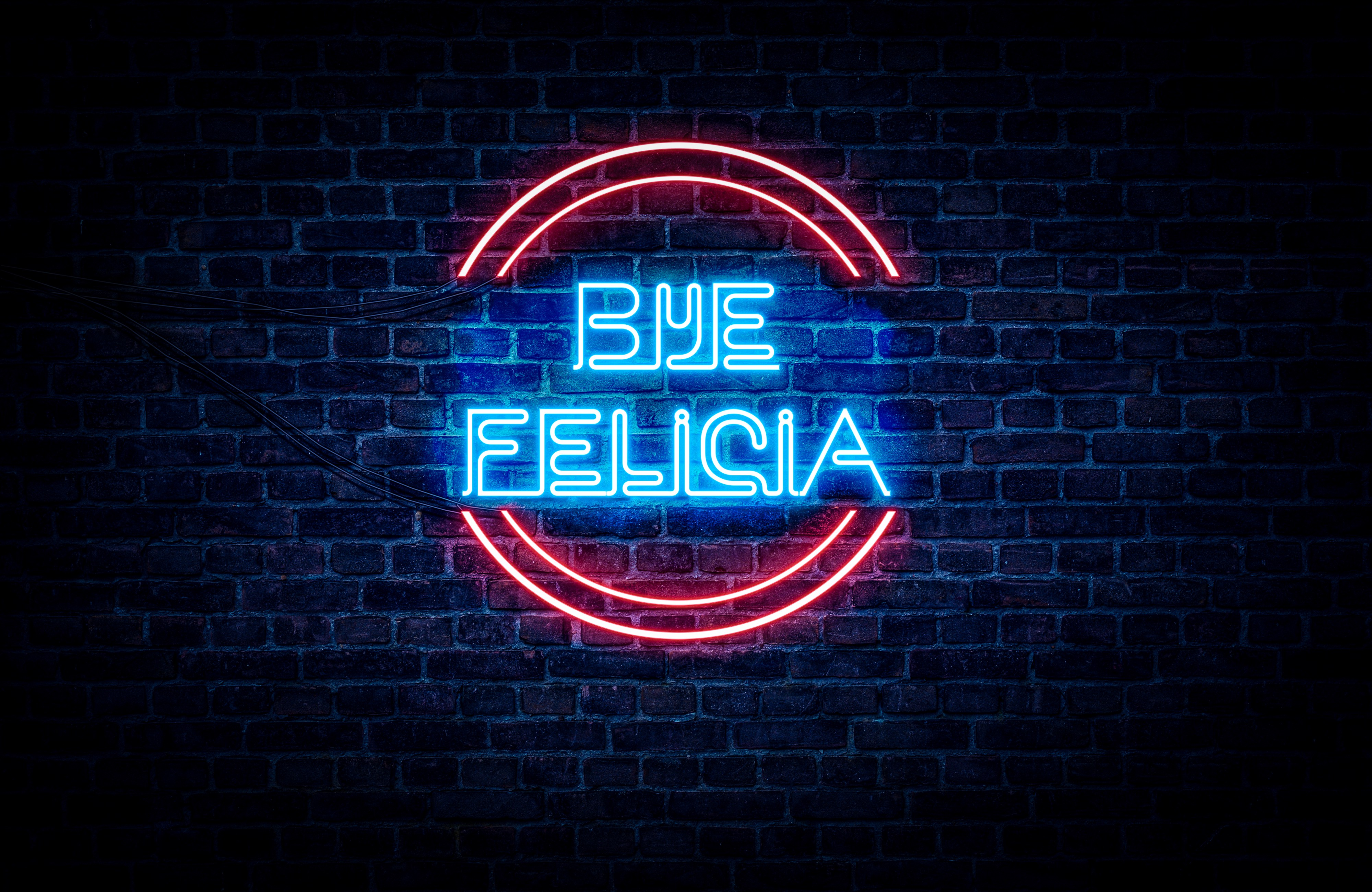 "A neon red and blue sign that reads ""bye Felicia"""