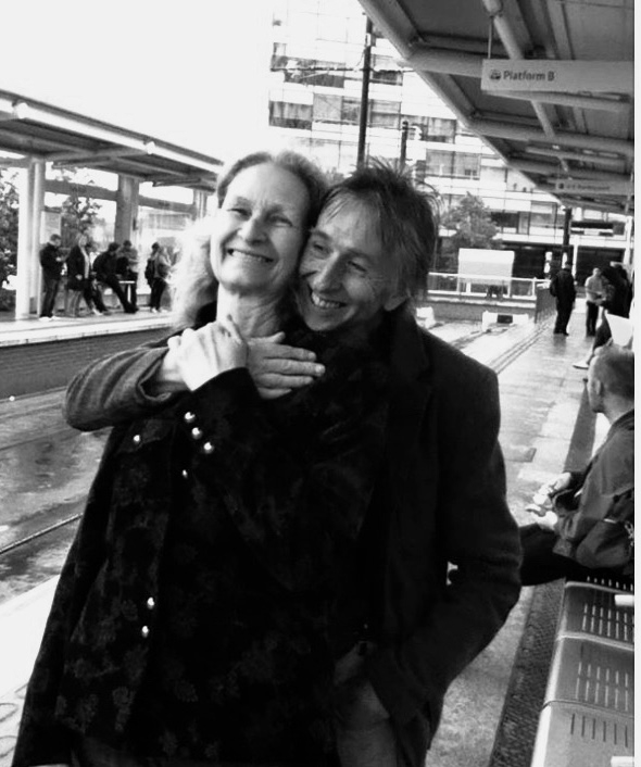 Lena and Alan MIles — happy in the rain at Media City Metro Station in Salford.