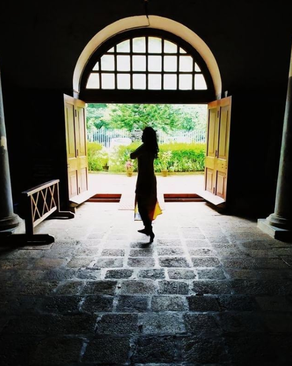 Hey, hope you're doing great. It's just silhouette figure of myself facing the light through the giant church door.
