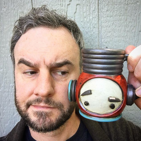 Michael Klapthor holds up his robot mug.