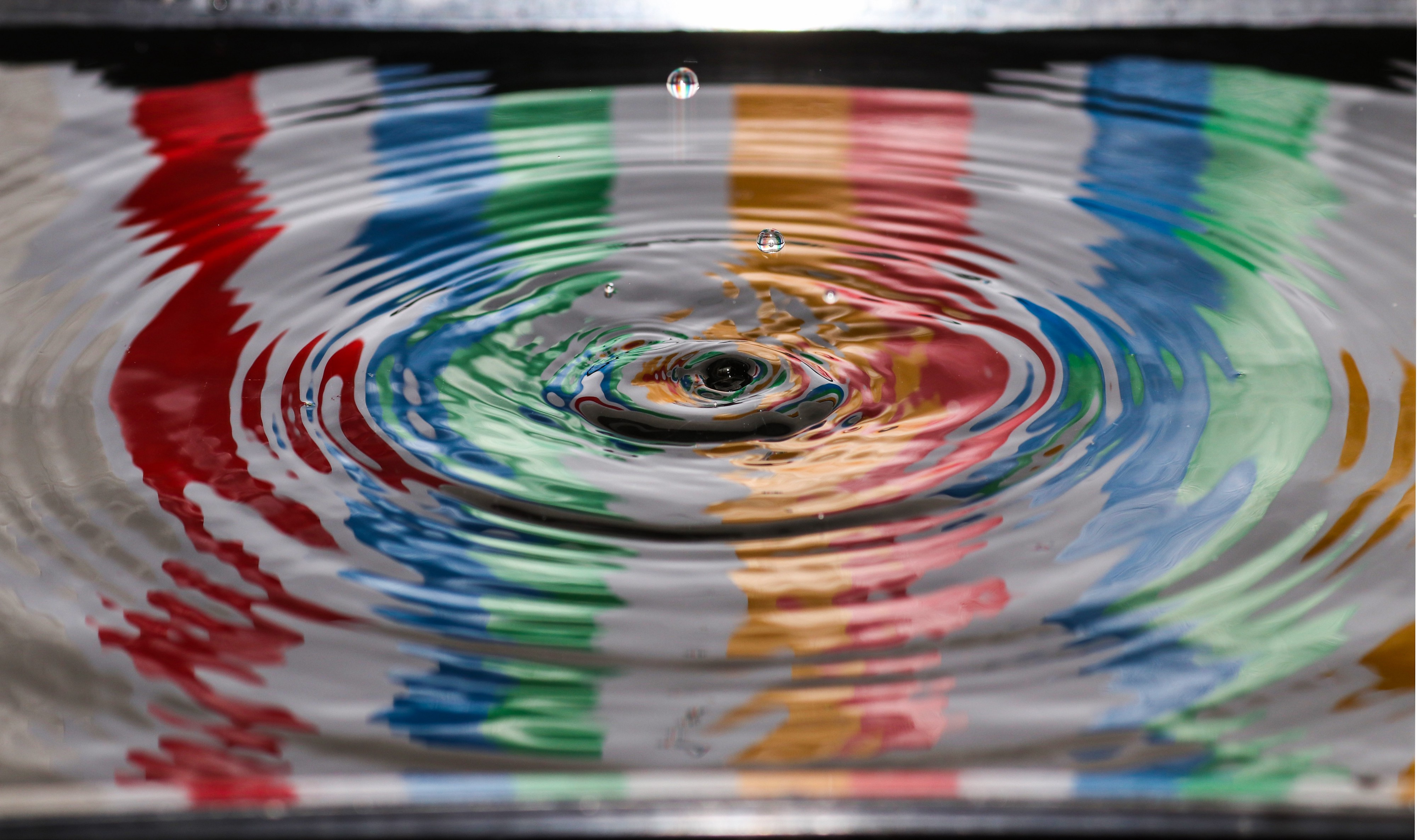 A drop of surface water with colours reflecting—Design A Digital Product For Sustainability by Paul Myers