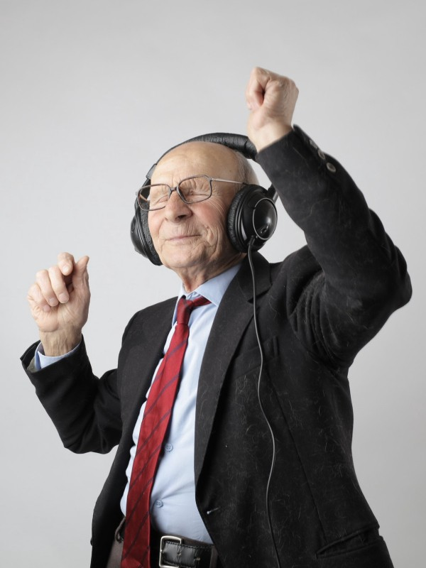 Elderly man with headphones, dancing