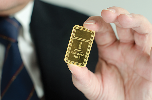 Person holding a single piece of solid gold