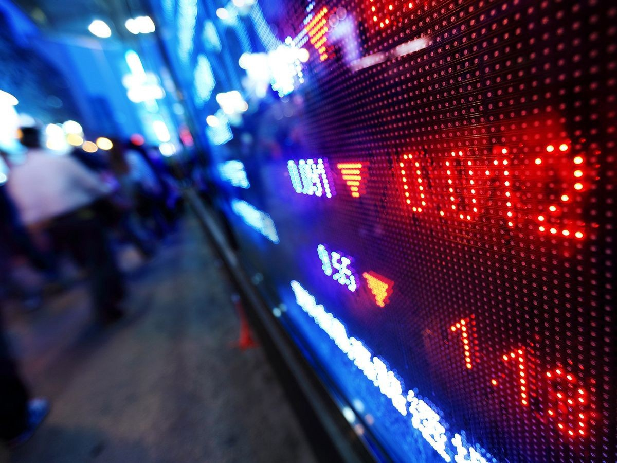 A close-up photo of a screen where stock value is dropping. Photo by samxmeg via iStock.com