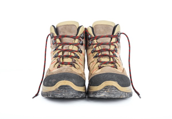 A muddy, well-used pair of hiking boots