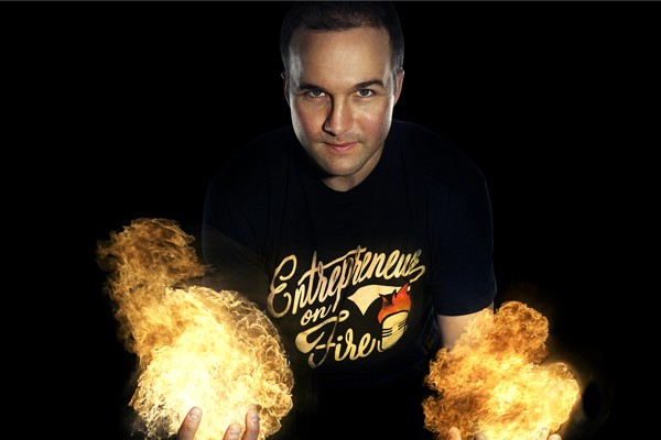 John Lee Dumas with fire in his hands