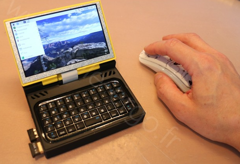 """0d2c3d9c852 This little terminal links a standard Bluetooth keyboard to a Raspberry Pi  concealed inside of a 3D-printed clamshell case. A 5"""" monitor is connected  ..."""