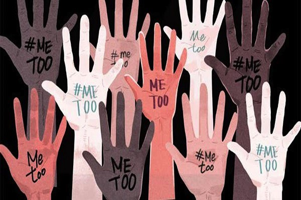 Ten hands raised up in the air with #METOO written on the palm