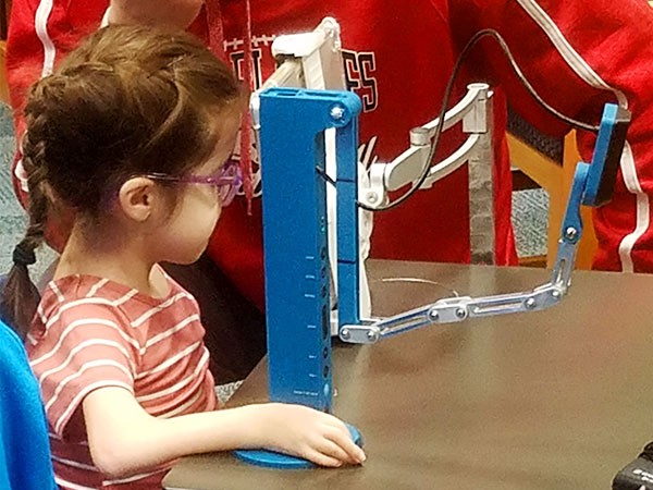 Payton trying out her newly designed document camera with her iPad. Photo courtesy of Brent Nummerdor.
