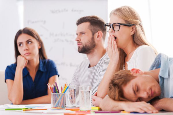 People bored and asleep in a meeting