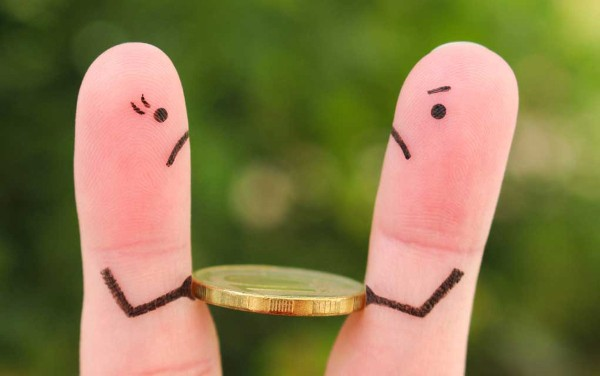 Two fingers fighting to hold onto a coin. What is your relationship with money?
