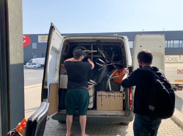 Team loading a van with office stuff.
