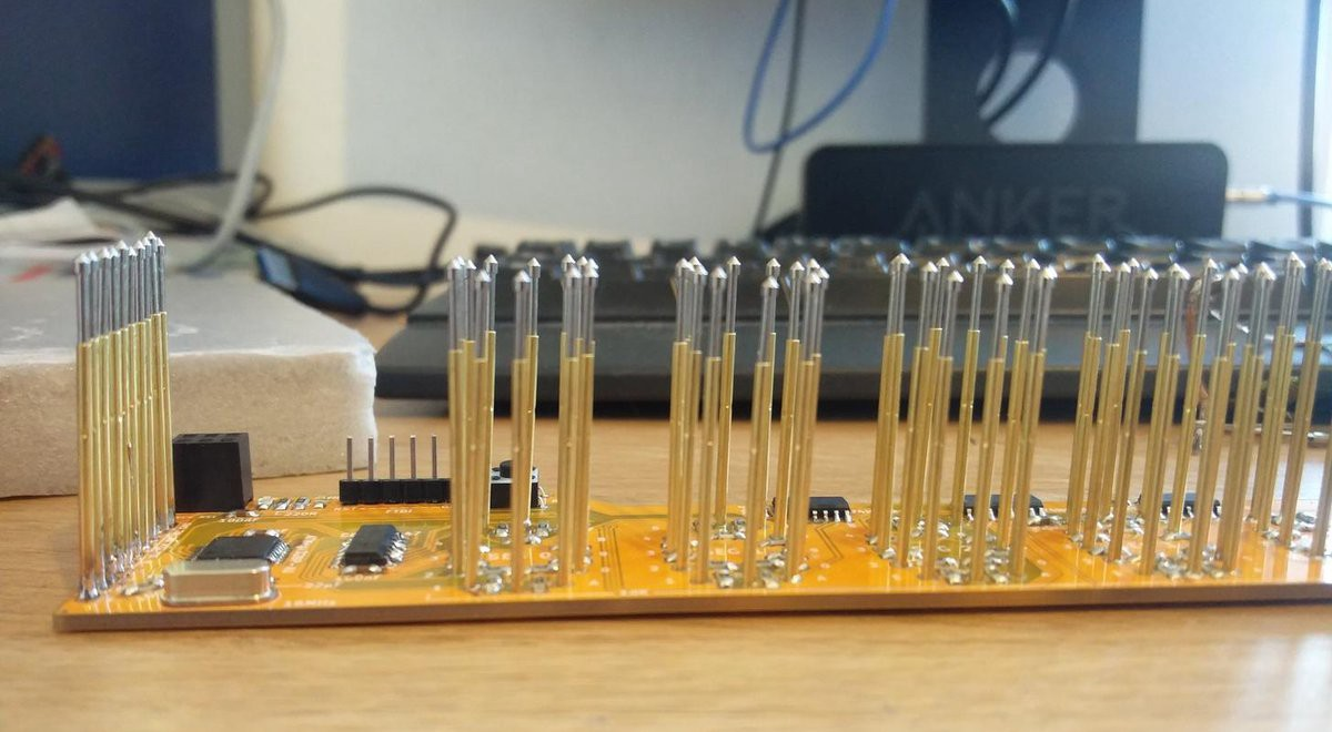 Test Nixie Tube Driver PCBs on a Bed of Nails - Hackster Blog